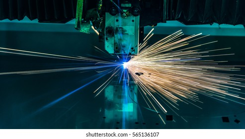 Industrial Laser cutting processing manufacture technology of flat sheet metal steel material with sparks laser cut metal splashes