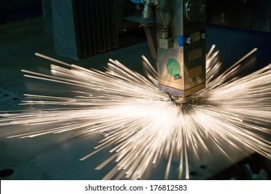 Industrial laser making holes in metal sheet