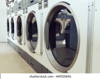 industrial laundry machines in laundrette