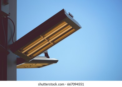 Industrial light fixtures with a blue sky