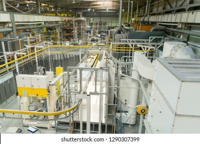 Industrial line of dry painting of metal products. Overhead conveyor system. View from above.
