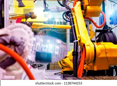 industrial line with robots on the sides, production and processing of metal parts, slective focus