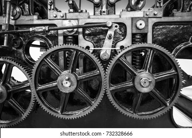 Industrial machine cogs in black and white.