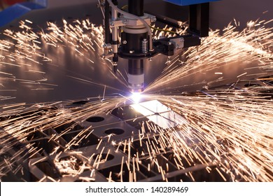 Industrial machine for cutting metal plasma. When his work sparks fly.