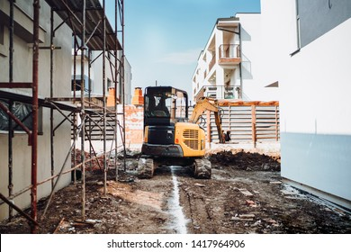 Industrial machinery on construction site, Mini heavy duty excavator moving earth for foundation building