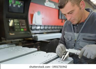 industrial man technician worker checking machine
