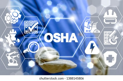 Industrial manager uses on a virtual screen of the future and sees the acronym: OSHA. OSHA - Occupational Safety and Health Administration Industry concept.