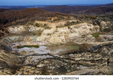 Industrial mining landscape from a drone. Aerial view of an abandoned open pit mine, nature pollution