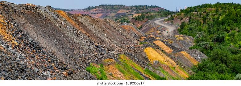 industrial mining waste dumps quartzite stones. Summer season. Web banner.