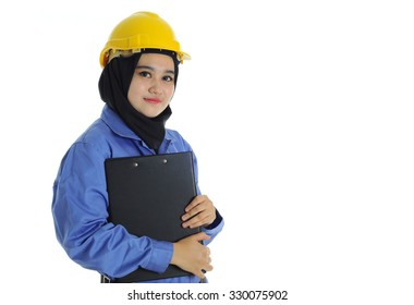 Industrial muslim women worker wearing coverall and hardhat with happy face