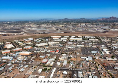 Industrial and office buildings adjacent to airport viewed from above