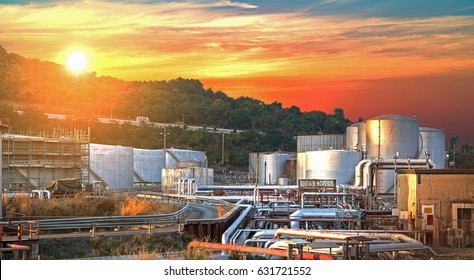 Industrial Oil and Gas Refinery,Close up Oil Tank zone with beautiful cloudy sky at sunrise