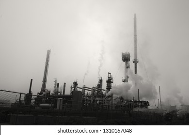 Industrial oil refinery and obscured sky.