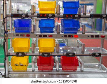 Industrial open plastic bin rack for component parts in warehouse