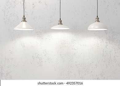 Industrial pendant lamps against rough wall