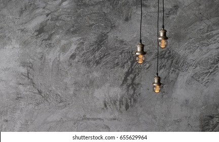 Industrial pendant lamps against a rough concrete wall. The interior of the loft style. Edison light bulbs. 3d rendering.
