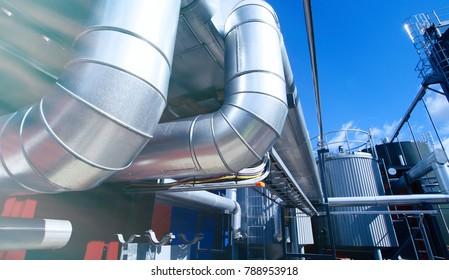 industrial pipelines on pipe-bridge against blue sky