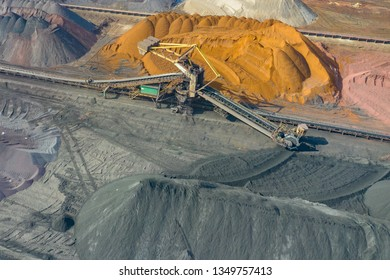 Industrial place from above. Mine storage place, mining minerals and black coal. Picture made by drone.