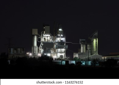 Industrial plant with chimneys and lights during night work