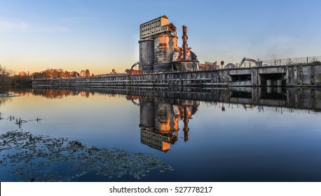 Industrial plant at dusk in the process of demolition with water reflection. Brunner Mond, Winnington, Northwich, Cheshire UK.