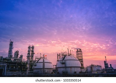 Industrial plant with gas product storage tanks on sunset sky background, Petrochemical plant