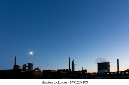 Industrial plant at night with deep blue sky
