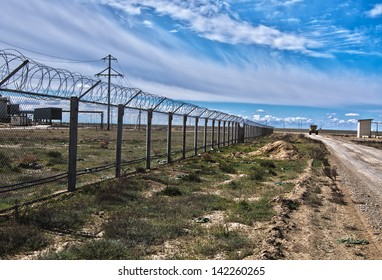 Industrial platform against the cloudy sky in the desert of Central Asia