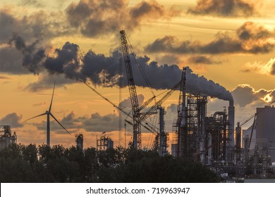 Industrial Pollution - An industrial skyline at dusk - Rotterdam in the Netherlands.