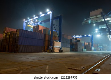 industrial port with containers. Stack of containers, gantry crane at night. Industrial Container yard for Logistic Import Export business