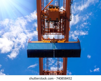 Industrial port crane lift up loading export containers box onboard at port of Thailand, Look up under the port crane operations.