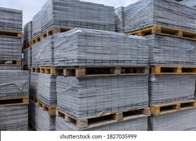Industrial production of building materials from pressed cement mortar. High quality paving stones. Finished products on pallets packed in film are waiting to be shipped.