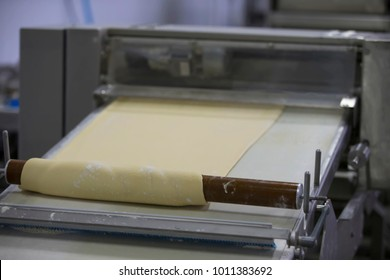 Industrial production of culinary products and bread.Yeast dough on the bread baking line
