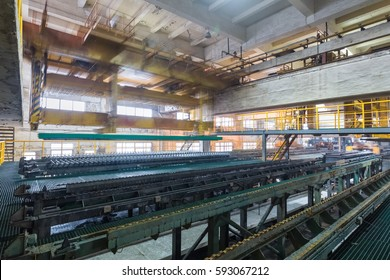 industrial production workshop closeup in a lead and zinc metal factory, automatic peeling zinc production line