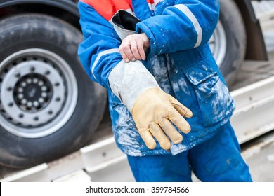 Industrial protective clothing, gear. The worker puts on a protective glove. Worker's gloves closeup. Worker's hands closeup.