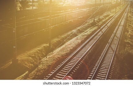 Industrial Railway with freight cars at sunset. Hipster toning