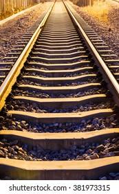Industrial railway track at dusk