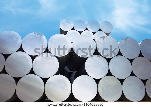 Industrial raw materials, Heap of aluminium bar in aluminum profiles factory.