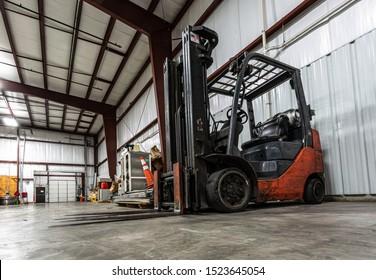 Industrial Reach Forklift Trucks. Rough Terrain Forklifts