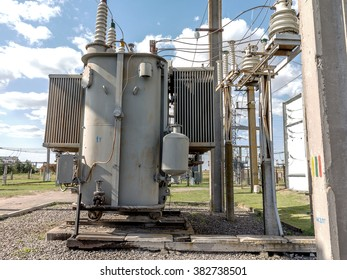 Industrial reduces power station. Power transformer on ceramic and porcelain insulators wire line transmission electron