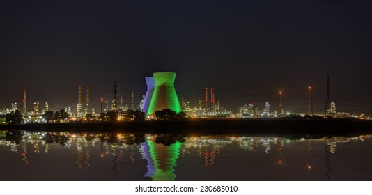 Industrial Refineries at night reflected in the water HDR