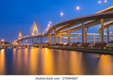 Industrial Ring road with suspension bridge river front, twilight