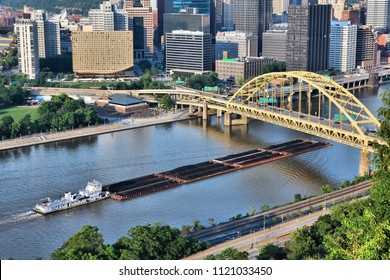 Industrial river shipping. Pittsburgh city, Pennsylvania. Monongahela River barge transport of coal.