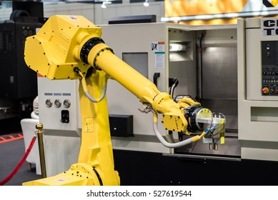 Industrial robot with CNC achine
