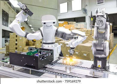Industrial robot installing a computer chip in production line manufacturer factory, Controller of robotic arm for performing, dispensing, material-handling and packaging applications.