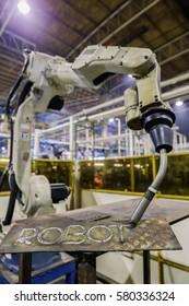 Industrial robot is test welding in robot training arear