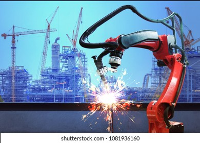 Industrial robot welder welding i beam steel structure construction by metal arc welding against industrial factory site in sunset