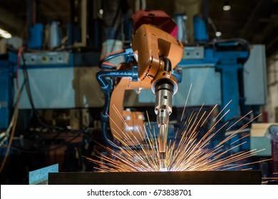 Industrial robot is welding test run program in car factory