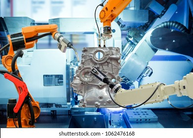Industrial robotic welding, robot gripping and robotic 3D scan working with auto parts on smart factory, on machine blue tone color background, industry 4.0 and technology, concept and idea