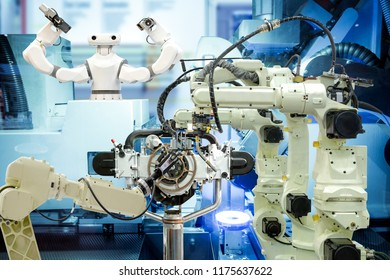 Industrial robotics welding, robotics 3D scan and smart robot working with engine parts on smart factory, on machine blue tone color background, industry 4.0 and technology concept