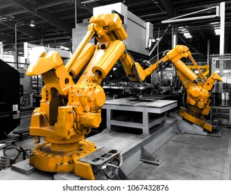 Industrial robots in production line manufacturer factory / Industrial robots in motion.